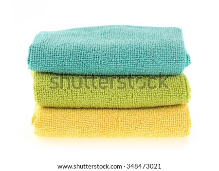 yellow and green towel rolls isolated on white background.