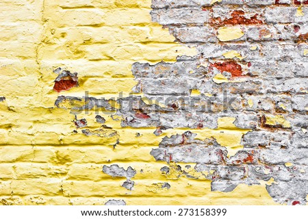 Yellow and grey bricks on a wall - stock photo