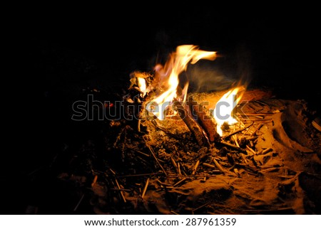 Yellow and orange flames bonfire at night  - stock photo