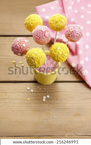 Yellow and pink cake pops, copy space - stock photo