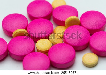 Yellow And Pink Pills - stock photo