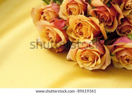 yellow and pink roses on gold satin