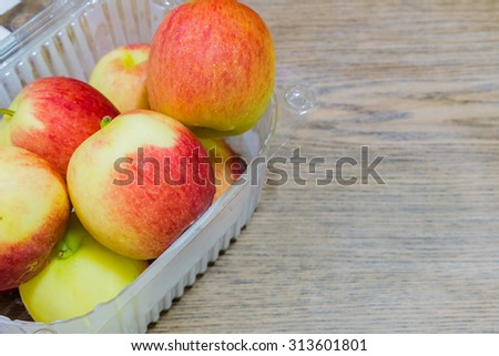 yellow and red apples on wooden blackground