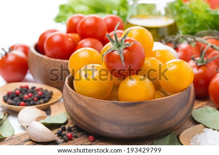 yellow and red cherry tomatoes and spices, close-up, horizontal - stock photo