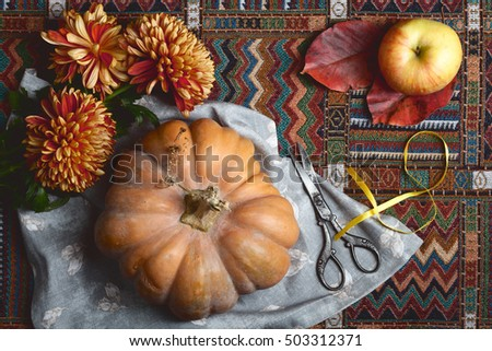yellow and red colors autumn background with pumpkin, apple, leaves, flowers and texture