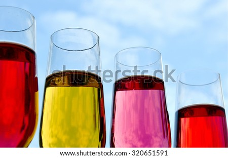 yellow and red drink with  sky background