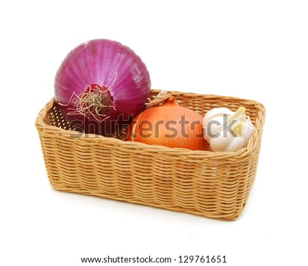 Yellow and red onions and garlic in basket on white