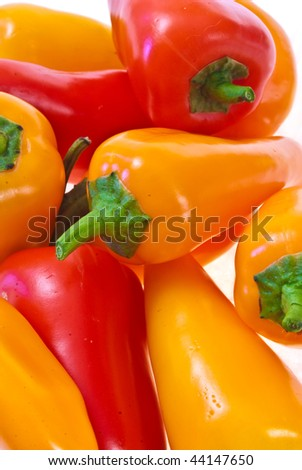 Yellow and red peppers on white background