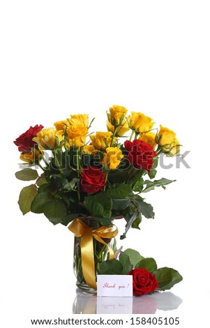 yellow and red roses in a vase on a white background - stock photo