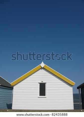 Yellow and white beach hut on sunny day in Southwold, Suffolk, England, UK - stock photo