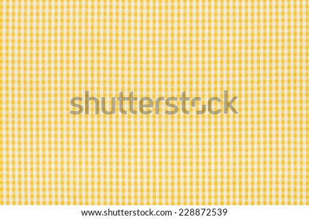 Yellow and white checkered fabric - stock photo