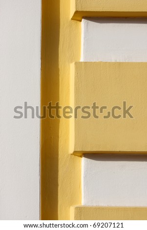 Yellow and white concrete texture with a shadow - stock photo