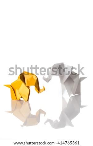 Yellow and white origami elephants family isolated on white background - stock photo