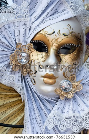 yellow and white venice carnival mask - stock photo