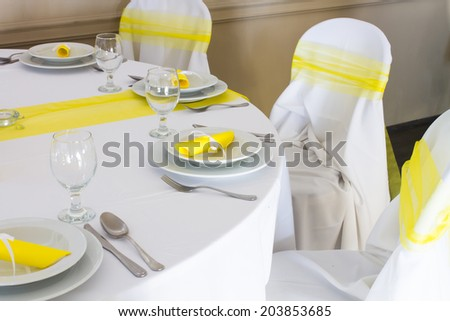 yellow and white wedding table decoration - stock photo
