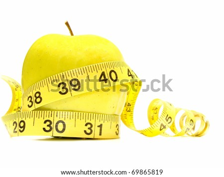 Yellow apple surrounded by measuring tape
