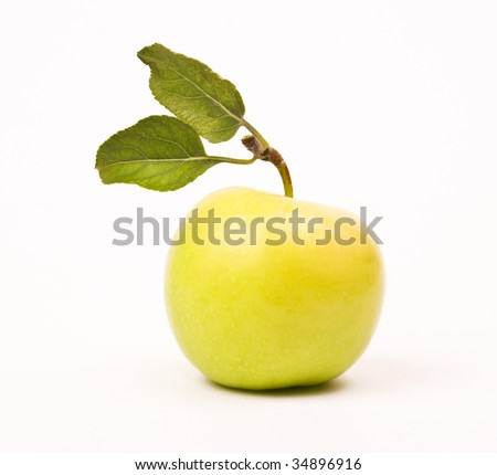 Yellow apple with leaf