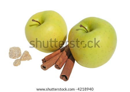 Yellow apples with cinnamon and sugar on on white background