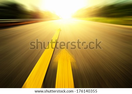 Yellow arrow Line exceeding each other on the road. - stock photo