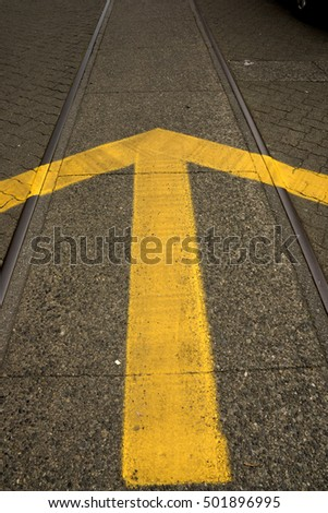 Yellow arrow on the road.