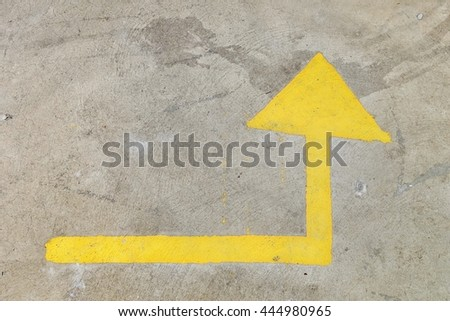 yellow arrow sign on the road