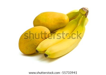 Yellow Asian mangoes resting on bananas with white background - stock photo