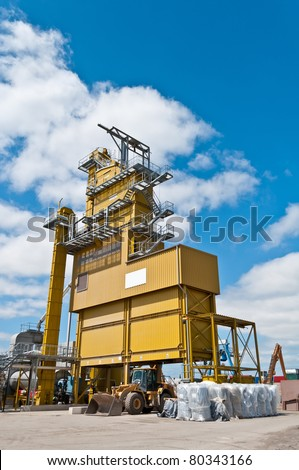 Yellow asphalt plant on an industrial site