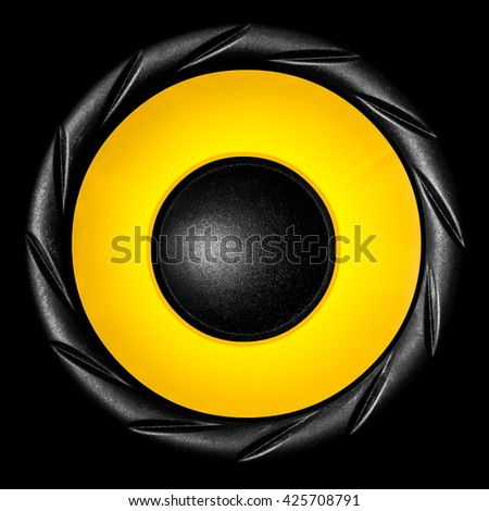 Yellow audio speaker isolated on black background - stock photo