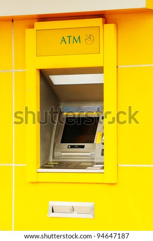 Yellow Automatic Teller Machine or ATM - stock photo