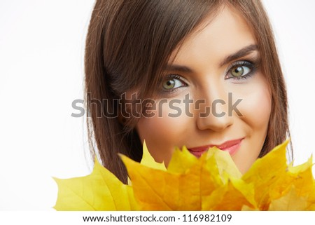 Yellow autumn leaves, close up woman face - stock photo