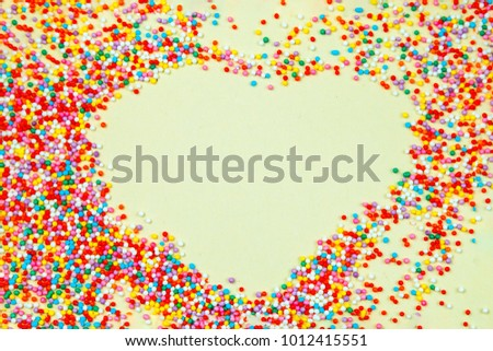 yellow background, confectionery sprinkling