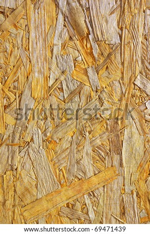 Yellow background surface of compressed yellow wood splinters and sawdust - stock photo