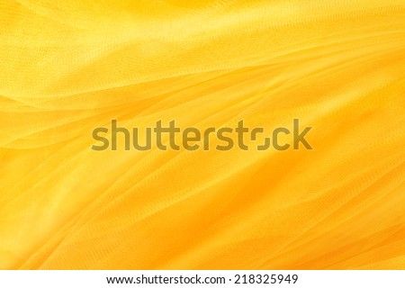yellow background, textiles and yellow mesh - stock photo