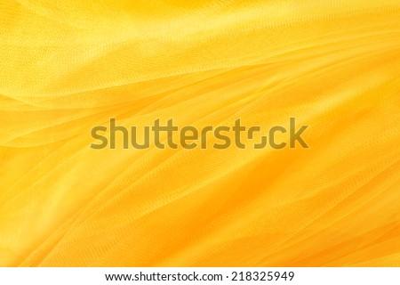 yellow background, textiles and yellow mesh - stock photo