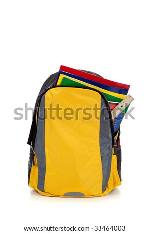 Yellow backpack with school supplies on a white background - stock photo