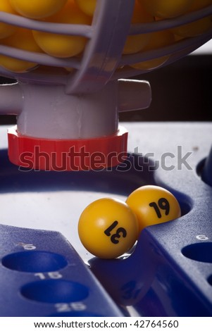 Yellow balls selected from the basket - stock photo