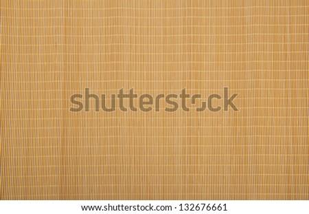 Yellow bamboo rug. Background - stock photo