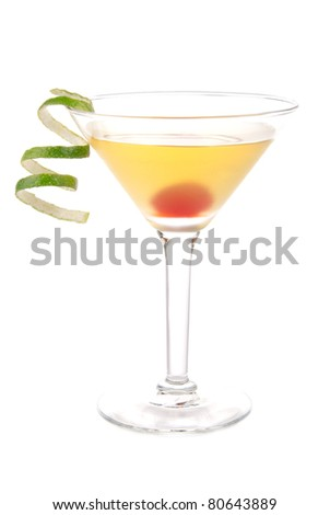 Yellow banana martini cocktail in martinis glass with lime twist and cherry isolated on a white background - stock photo