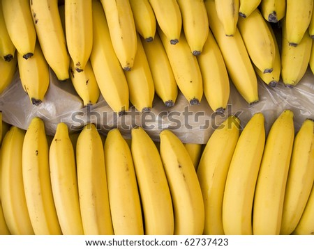 Yellow bananas in a box on sale