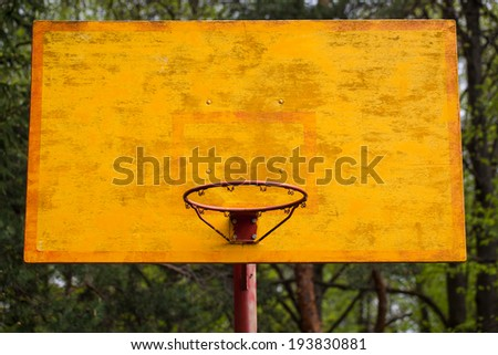 yellow basketball backboard with a ring in the park - stock photo