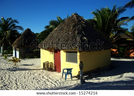 Yellow beach hut - stock photo