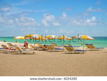 Yellow beach umbrellas - stock photo