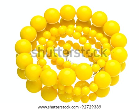 yellow beads isolated on white background