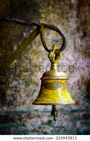 Yellow bell in a temple in Kathmandu, Nepal - stock photo