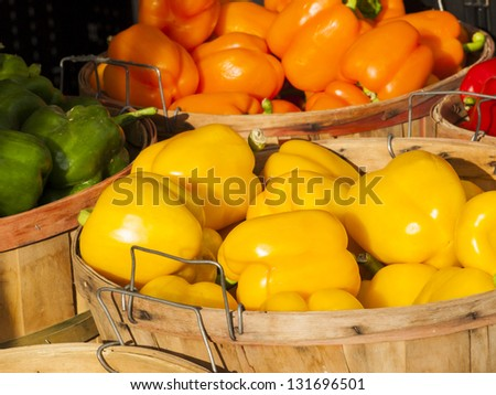 Yellow bell peppers at the local farmer's market. - stock photo