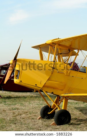 Yellow bi-plane - stock photo
