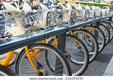 Yellow bikes parking on the street in Europe - stock photo