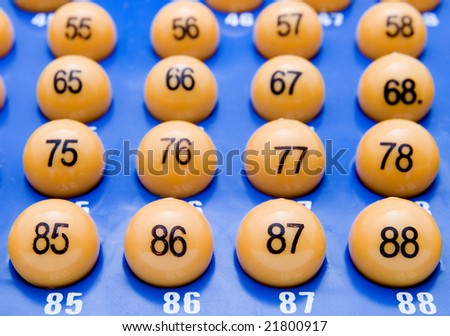 yellow bingo balls on blue background - stock photo
