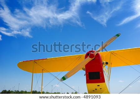 yellow biplane - stock photo