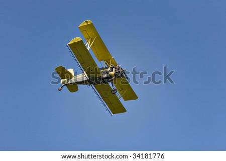 Yellow biplane, crop duster. - stock photo